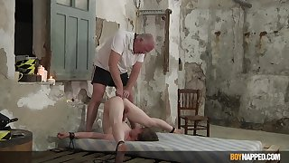 Slim twink endures old man's vilifying punishment in serious anal BDSM deception