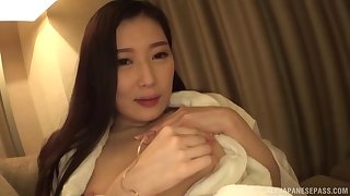 Brunette long haired Japanese housewife Sakai Eriko plays with a cock
