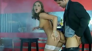 Babe in fishnets Veronika blows a long cock at a bar