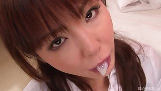 Cute Japanese brunette teen gets a cumshot in her mouth